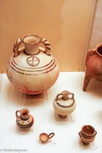 Ceramic vessels in exhibition case.