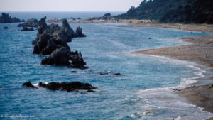 Dramatic sea rocks frame the beach