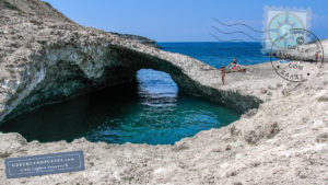 Rock arch over a swimming hole in Kapros