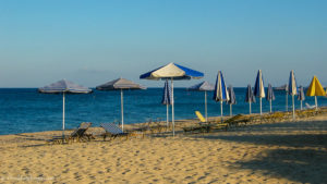 Sand and parasols at Spithi beach