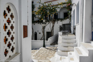 White walls, stairs, and bougainvillea