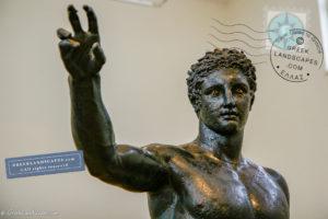 Torso and hand of bronze statue