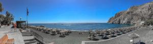 Beach panorama with straw parasols