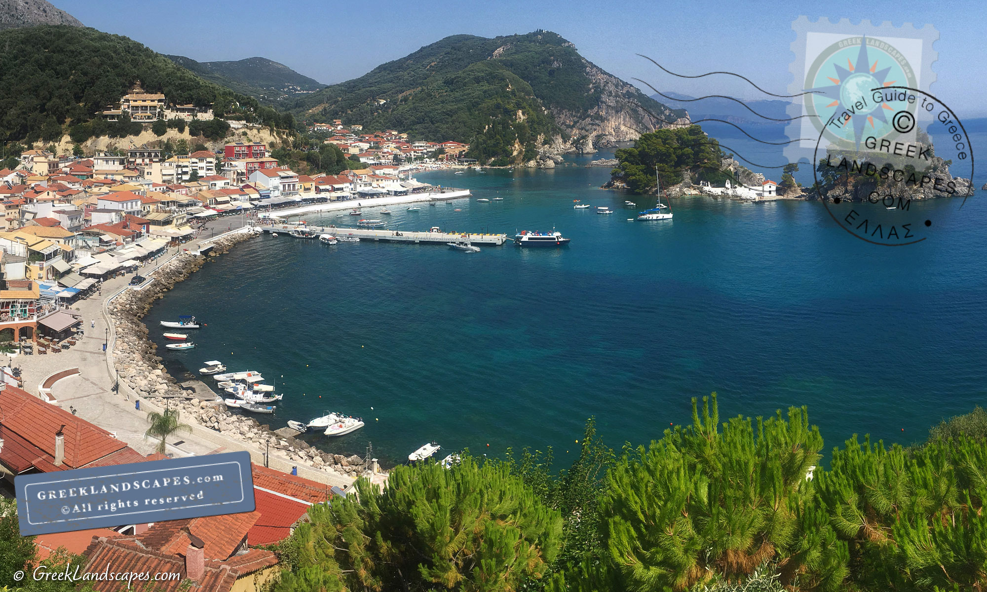 View of Parga town with Panagia islet and boats in the harbor