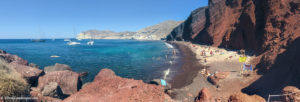 Beach with red colored rocks and blue water