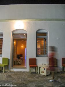 Bar doors and pedestrian at night