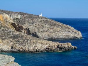 Rugged coast with white lighthouse